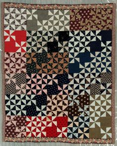 "Pieced quilt, 1895-1905, whirligig variation. Thirty 9 1/2"" cotton print blocks.  Grand Rapids Public Museum (Michigan)"