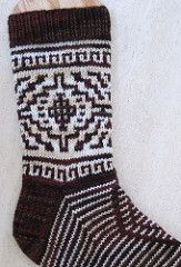 These socks are knitted from the top down and have a standard heel flap and gusset. The Southwestern design was inspired by the geometric patterns in Navajo rugs.