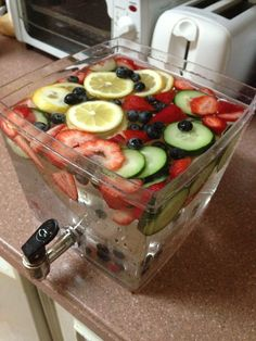 Detox water - lemon, cucumber, strawberries, and blueberries