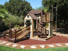 a cool playhouse with swing set elements built in