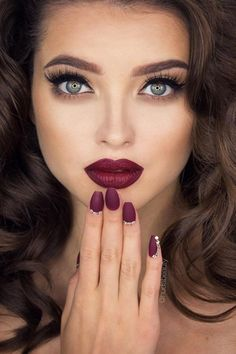 dramatic eye makeup and bold lips.
