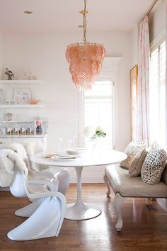 White dining nook with pink accents