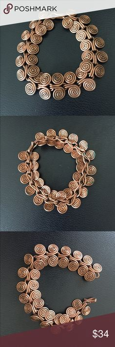 """Vintage Copper Bracelet This beautiful and unique genuine copper bracelet features s fancy swirl design and hook closure. Measures 7"""" x 3/4"""". In excellent preowned vintage condition. Smoke-free home. Vintage Jewelry Bracelets"""