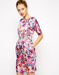 Dress in bright floral print. The print and colours are so vibrant! I would wear this with nude pumps.