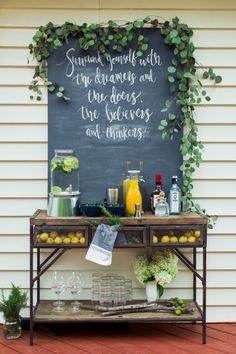 Rustic bar and chalkboard covered in garland: Photography: Rachel of Blue Barn Photography - www.bluebarnphotography.com   Read More on SMP: http://www.stylemepretty.com/2016/08/28//