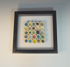A personal favorite from my Etsy shop https://www.etsy.com/listing/160641824/3d-art-tile-cups-of-rainbows-recycled