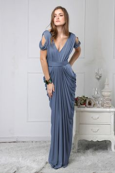 The Darla features a deep-V neckline, draping on the sleeves, a wide belt, #Bridesmaid #Steel #Blue