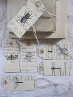 old book pages and stamps to make tags