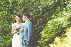 Bride & Groom in lush, green summer gardens on the vintage wedding day. The Black Swan, Helmsley, North Yorkshire.