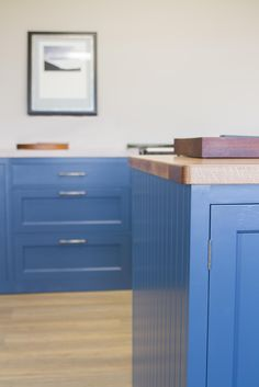 With this bespoke wooden kitchen, we softened the vibrancy of the Farrow & Ball Stiffkey Blue #cabinets with the golden tones of an Appalachian White #Oak #worktop, as it provides just the right amount of an elegant homeliness to the style of this #kitchen.  www.nakedkitchens.com