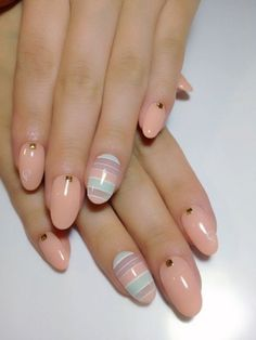 Cute and simple. The baby colors look amazing and clean on this piece of nail art. Great for pajama parties or simply hanging out with your girlfriends. The little gold beads on top add a bit of mature attitude into the nails nevertheless it succeeds in giving the impression that you're pretty, cute and at the same time ladylike.