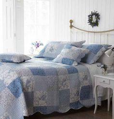 Simply Lovely - Blue and white reversible quilt with scalloped edging.