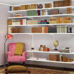 Living room with elfa solid shelving (from elfa.com) is a beautiful way to provide structure and a pretty little reading nook.