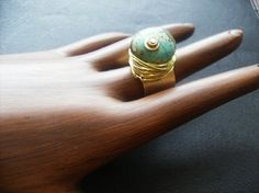 Turquoise and Brass Ring Adjustable by jazjewelz on Etsy, via Etsy.