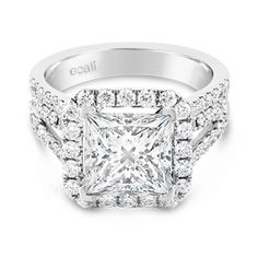 Ecali Presents: An unparalleled standard of quality and workmanship are evident in this magnificent princess cut diamond engagement ring with a triple diamond band and claw set halo.