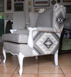 Reupholstered Wing Back Chair with Aztec Print. $550.00, via Etsy.