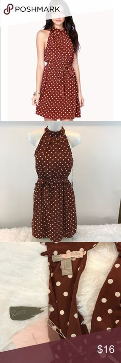 Forever 21 Dress Brown/rust color with white polka dot dress.  The dress has an elastic waist with a matching tie belt.  The back has two button closure at the back of the neck.  Open back from the waist up.  The skirt portion of the dress is lined.  Really cute and reminds me of a dress worn in a famous movie, that I'm sure we've all seen. Forever 21 Dresses