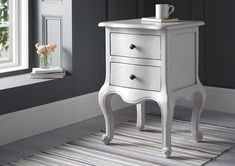 An elegant 2 drawer French style bedside cabinet finished in a beautiful warm grey colour. A perfect partner for our lovely Emily bed frame.
