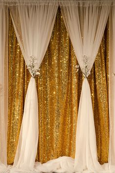 Add drama to your next event with a glittering gold sequin backdrop