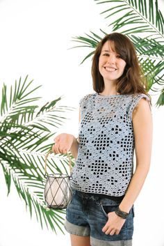 Diamonds can be a crocheter's best friend, too, especially when they look this stylish! This regal top uses a combination of filet crochet and diamond motifs to create an eye-catching summer look.