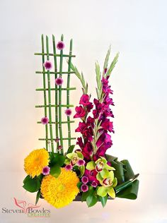 Modern Floral Arrangements of Gladiola's, Sun Flowers and Orchids.  Designed by Steven Bowles Creative, floral and event designers, Naples, FL. www.stevenbowlescreative.com