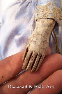 carved wooden doll hands