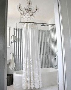 LOVE the corrugated metal tub surround.  It would go perfectly with my NYC-themed bathroom.  And wouldn't the sound be cool??