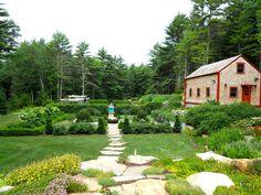 Parterre garden with mill wheel fountain, peastone paths edged in steel frame…