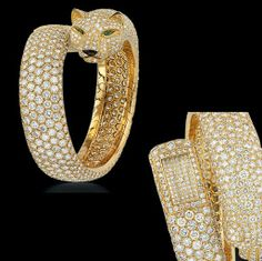 A LADY'S PANTHER BANGLE WATCH, BY CARTIER $200500.