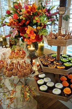 This is why I love the fall season. Rustic Halloween Sweets on cake stands and tiered displays. Change out the cupcake designs for Thanksgiving.