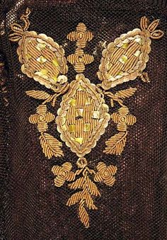 Detail of the goldwork decoration on the backs of a pair of net mittensmachine knitted net, gold purl, spangles, gold plate, beadsc.1800-1850