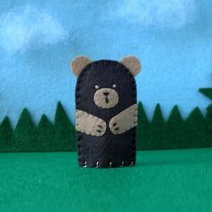Hey, I found this really awesome Etsy listing at http://www.etsy.com/listing/66908003/dark-brown-bear-finger-puppet