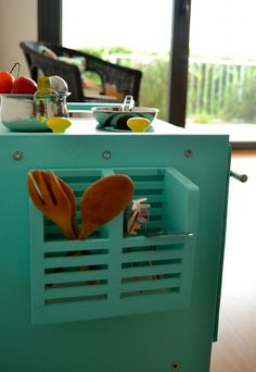 I like the two compartment storage area for cooking utensils mounted on the side of the cabinet.