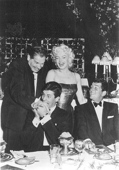 Marilyn with Milton Berle, Jerry Lewis and Dean Martin at the New York Friar's Club Testimonial Dinner, March 11, 1955.
