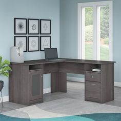 As fashionable as it is functional, this L-shaped executive desk anchors your home office in style. Available in a curated selection of classic finishes, this desk is crafted of manufactured wood with lam