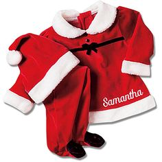 A Personal Creations Exclusive! Be sure to have your camera ready! These Little Girl Santa Suits are made of bright red velour, the top features black buttons and a faux fur collar, cuffs, and hem. Pull-on pants feature a comfy elastic waistband and feet. A traditional Santa hat is included. We embroider any name, up to 9 characters on each. Available in 6, 12, 18, and 24 months. Made of polyester. Machine wash/dry.