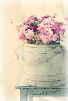 Pink and purple flowers in a shabby chic bucket