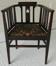 LX_46 Arts & Crafts oak desk chair with inverted heart cut out covered in Sunflower velvet fabric by Morris & Co.  Sanderson. Circa 1900.