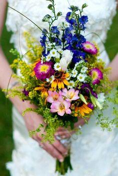 Rustic/Shabby Chic/Boho/Country Wedding Bouquet Showcasing: Blue Delphinium, Fuchsia/Yellow Zinnias, Yellow Sunflowers, Pink Freesia, Purple Stock, Monte Casino Asters, Additional Coordinating Florals, Yellow Solidago & Greenery/Foliage