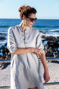 Linen Shirt Dress. Borrowed from the boys and modified into the ultimate feminine creation. For functionality we added inseam pockets and adorned the neckline with some charming buttons. The dress has three quarter sleeves you can roll up in the summer or wear down on those colder days paired up with tights. Linen clothing. Natural fiber. Casual wear. Camps Bay. Cape Town. Fashion Gem. Natural high. All a girl wants. Timeless Classic. Three quarter sleeve. Wooden Buttons. Linen Shirt Dress, Cold Day, Timeless Classic, Camps, Cape Town, Clothing Items, Summer Time, Casual Wear, Going Out