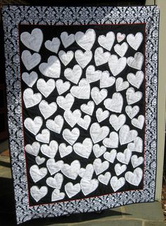 This is a custom order quilt for an alternative to the usual Wedding Guest Book. This is a very Special Keepsake! This allows your friends and family to write you a little note of love that you can cherish forever. What a fabulous gift this would be for the newlyweds! I was inspired by a pillow from Anthropology when I designed this quilt. There are 3 different sized hearts, raw edge quilted which is designed to fray and ruffle. The bride chose the background color, and border pattern. This…