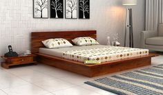 Create a luxurious bedroom with the elegant and comfortable design of Dwayne Double Bed from Woodenstreet. It is a low platform bed which is made from Sheesham . Wooden King Size Bed, Bed Designs With Storage, Bed Design, Bed Design Modern, Bed Back Design, Bedding Master Bedroom, Bedroom Bed Design, Bed Designs India, Modern Bedroom Furniture