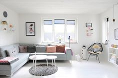 Scandinavian living room, soft colours and simple shapes