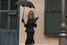 What to wear: All black, clearly. The black gloves are key, plus a black umbrella with exaggerated spokes. How to act: Like you're the Supreme, duh.