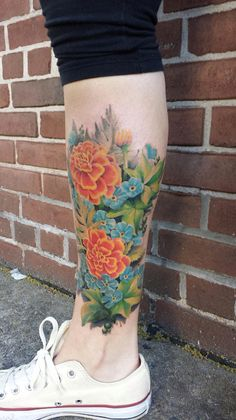 Forget-me-nots and marigolds. Cover-up tattoo!