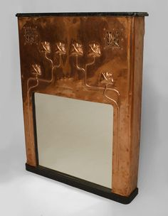 French Arts & Crafts narrow copper console table (originally fireplace surrounds) with floral design & 2 filigree cutouts with black marble top (signed E. REGIUS)