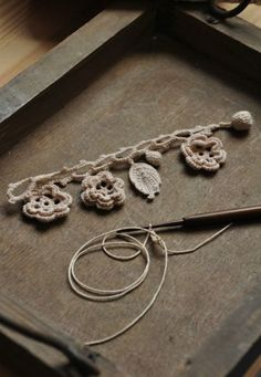No link but a beautiful crochet charm bracelet.....