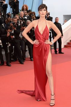 Bella Hadid Wears a Little Red Dress and a Lot of Fashion Tape on the Cannes Red Carpet