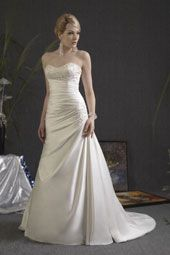 Angel & Tradition wedding dress/gown- ivory a-line style wedding dress with gathered bodice and bodice beading, strapless and sweetheart neckline. For the Bride Boutique Ft. Myers, Florida