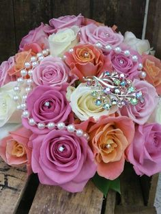 Aqua, Avalanche and Miss Piggy rose wedding bouquet with pearl and diamante brooch